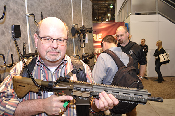 Here I am at the 2015 SHOT Show, posing with a Heckler and Koch 416 assault rifle. This is Jonathan Grave's main firearm and is referred to in the books by its Marine Corps designation of the M27.