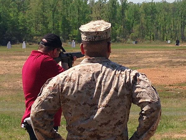 I was invited to Marine Corps Base Quantico (Virginia) to play with captured weapons. Here I am firing a Heckler and Koch G3 assault rifle. Notice the attentive range safety officer.
